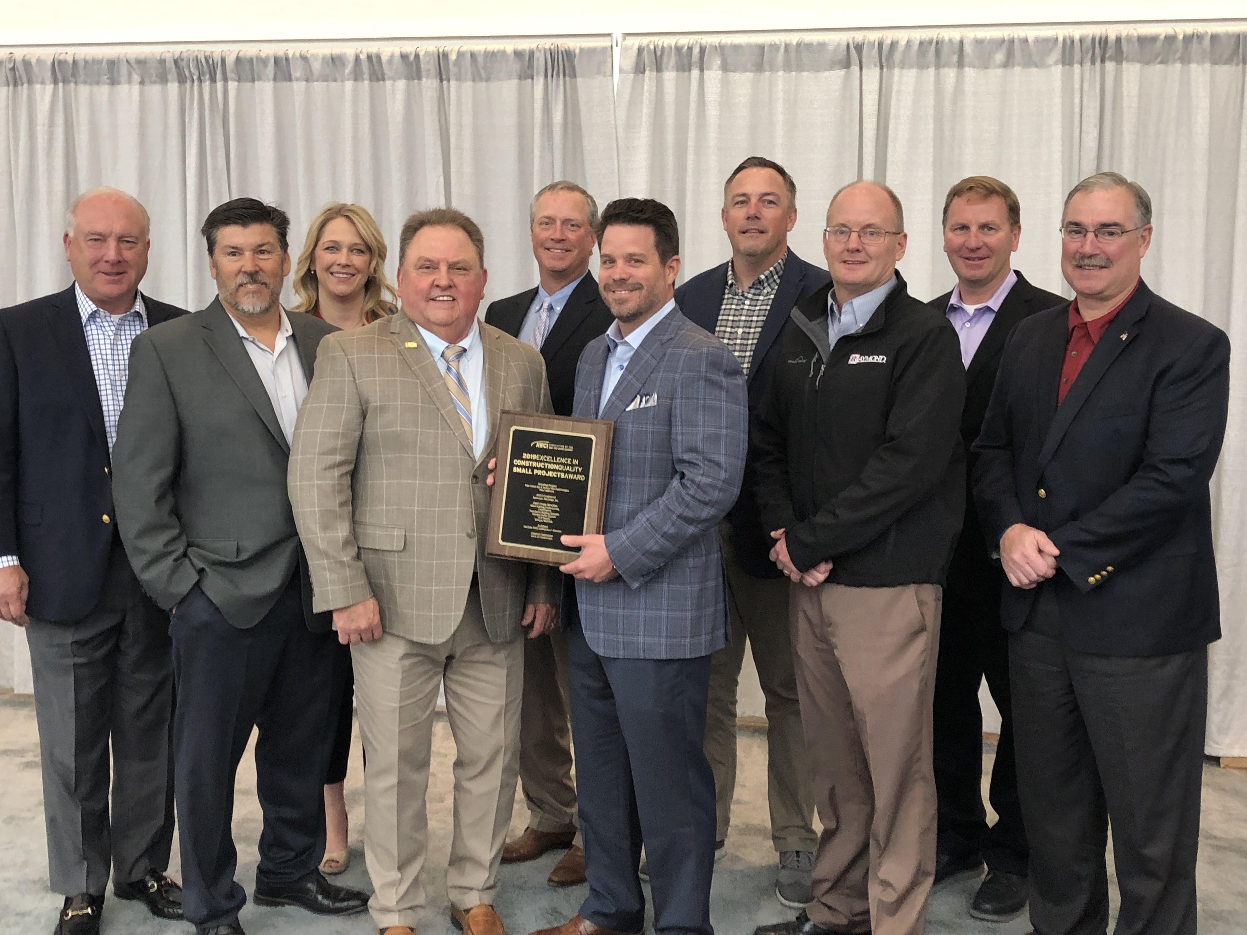 AWCI President Jerry Smith presenting Raymond-San Diego, Inc. with the AWCI Quality Award